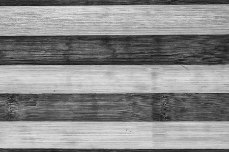 Dark and light brown vintage wooden old planks background. Black and white stripped texture.