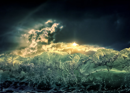 Dramatic dark ocean sea storm view with sun light clouds and waves. Abstract nature background. Climate concept. Extreme weather.