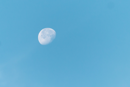 bright blue morning sky with the half moon Stock Photo