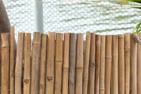 japanese garden: Bamboo fence for interior or exterior design.Simple brown bamboo pattern