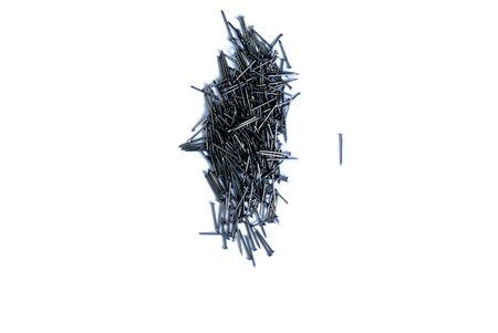 Small steel nails group isolated on the white background with have one steel nails separate from the group,Construction materials,Dare to do something new