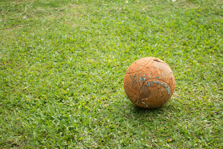ballsport: The old soccer ball on soccer field. Stock Photo