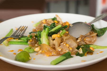 stir up: Close up stir fried fresh rice fat noodles with chicken and egg