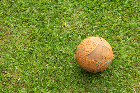 ballsport: The old soccer ball on soccer field. Stock Photo