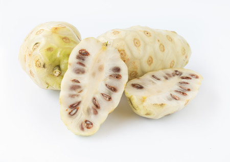 Noni or Morinda citrifolia, great morinda, Indian mulberry, beach mulberry, or cheese fruit on white background. Stock Photo