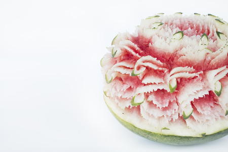 culinary arts: carved watermelon on white background. Stock Photo