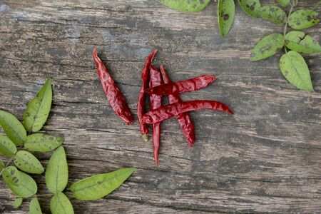 hottest: Dried red chilly pepper on wooden panel.