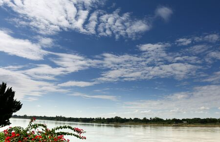 Clouds over river in mid day.