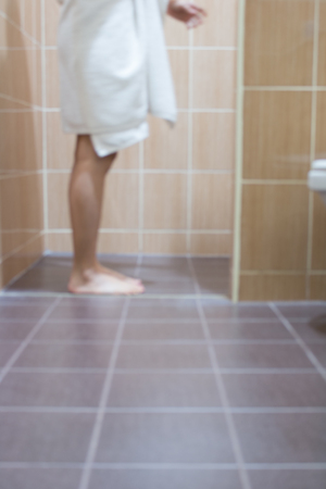 a toilet stool: Blurred of woman on toilet.