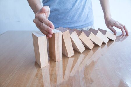 hand stop: Hand stop dominoes continuous toppled.