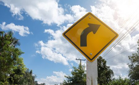 skidding: Road Signs warn Drivers for Ahead Dangerous Curve.