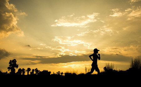 Fitness silhouette sunrise jogging workout wellness concept.