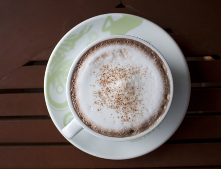 frothy: Closeup of A cup of Latte Art hot coffee over wooden  table top background in coffees shop. Stock Photo