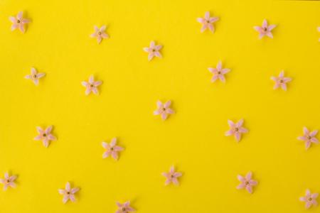 Little  flowers pattern on yellow background.
