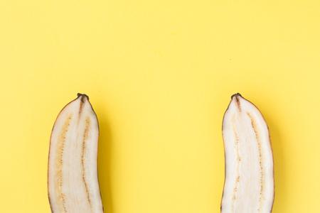 Sliced Yellow banana on yellow background.
