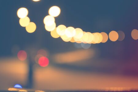 business scene: Blurred light on road in city with bokeh abstract background.