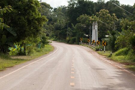 Road Signs warn Drivers for Ahead Dangerous Curve.