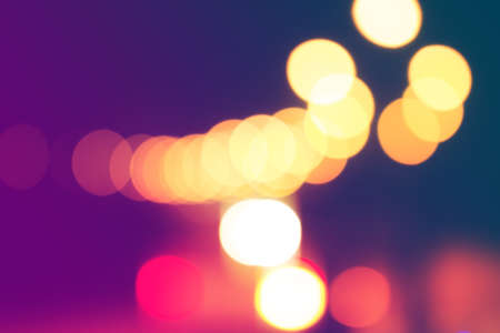 Blurred light on road in city with bokeh abstract background.