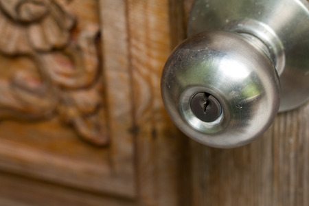 Soft focused of Door handle with lock hole for key. Stock Photo