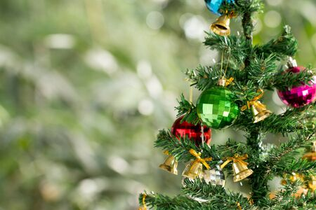 Decorated Christmas tree  with colorful ornaments and copyspace design for make background.
