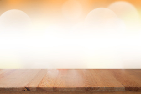 Empty desk with blurred light orange gradient bokeh abstract background.