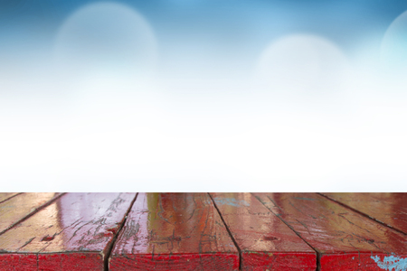 Empty of top wooden desk with Blurred light blue gradient bokeh abstract background.