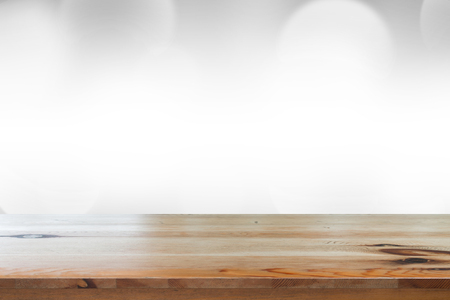Empty of desk with blurred light gray gradient bokeh abstract background.