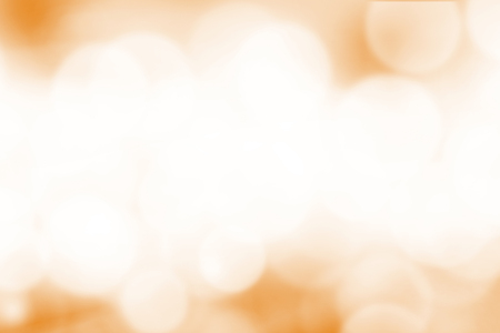 Blurred light orange gradient bokeh abstract background.