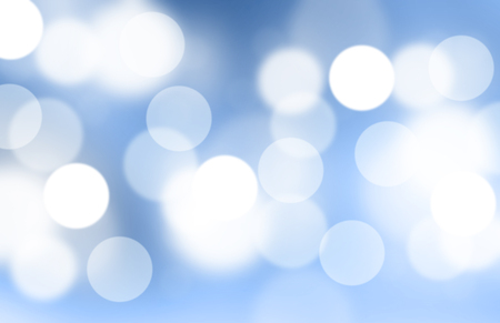 Lights or blurred bokeh on blue gradient background.