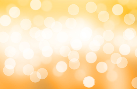 Blurred light yellow or gold gradient bokeh abstract background.