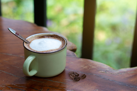 A cup of Piccolo Latte  on wooden desk, Relaxing time or coffee's break time during work day.