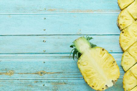 Ripe pineapples summer tropical fruits on pastel turquoise background. Summer fruit concept. Imagens
