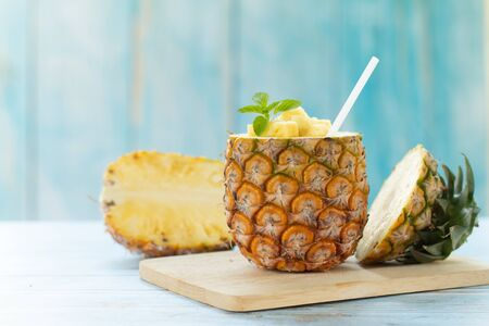 Pineapple Juice Pieces Pineapple Healthy Drink and summer fruit drink Concept.