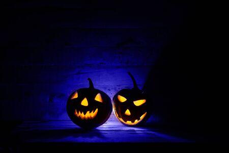 Halloween pumpkin head jack lantern in dark background. Stock Photo