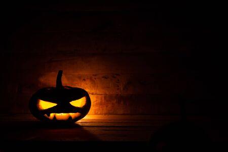 Halloween pumpkin head jack lantern in dark background.