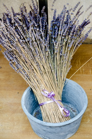 Violet dry lavender flowers in the blue ceramic pot photo
