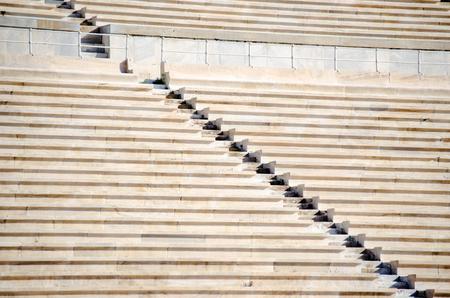 Rows of stone seats at stadium Stock Photo