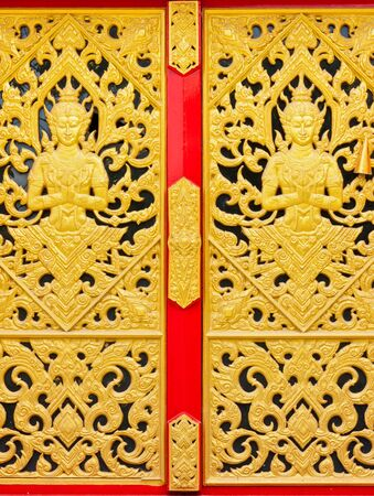 Thai art doors at the temple photo