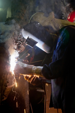 Welder construction in factory industrial photo