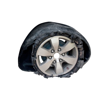 Broken tyre isolate on white Stok Fotoğraf