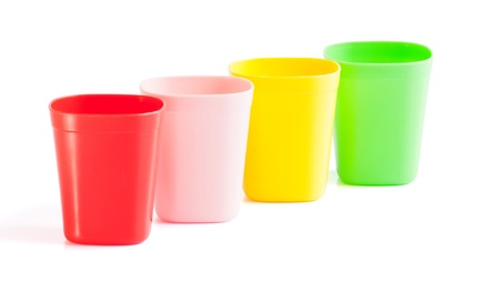 cup four: Four plastic cup place on white background Stock Photo