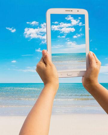Tablet on the beach Thailand trip