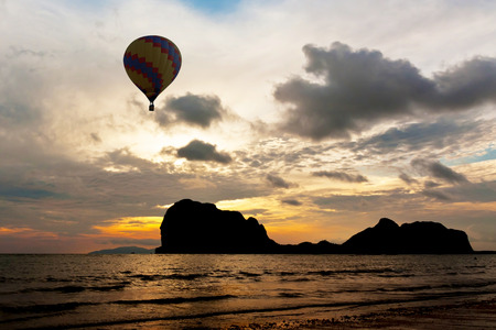 Balloon above black mountain in Thailand photo