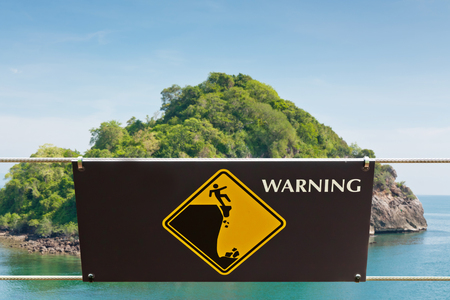 Warning sign at hill park in Thailand photo