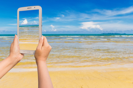Tablet vacation on the beach photo