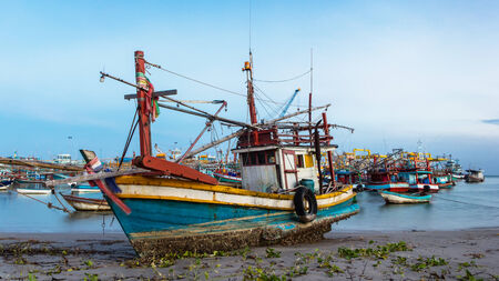 industrial park: Industrial fishing boat park at beach in Thailand Stock Photo