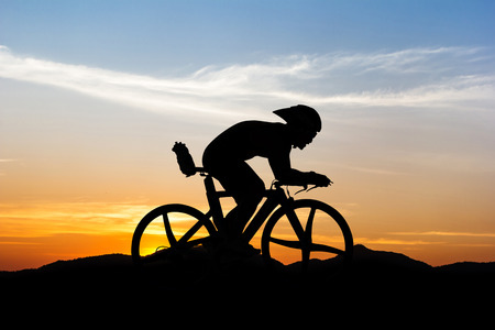 Cycling triathlon at mountain on twilight Stok Fotoğraf