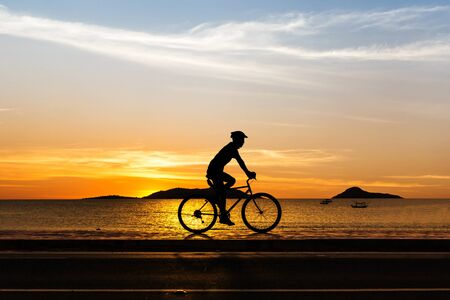 Man cycling at beach on twilight summer season in Thailand Asia