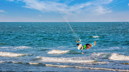 Kite boarding water sport at clean beach in Thailand Asia Stock Photo