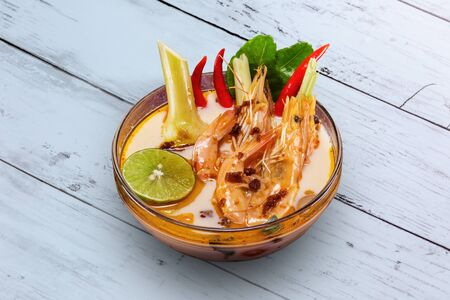 Shrimp soup Thai food on wooden table